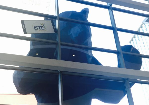 """I See What You Mean,"" aka the giant blue bear peering into the lobby from outside of the Denver Convention Center"