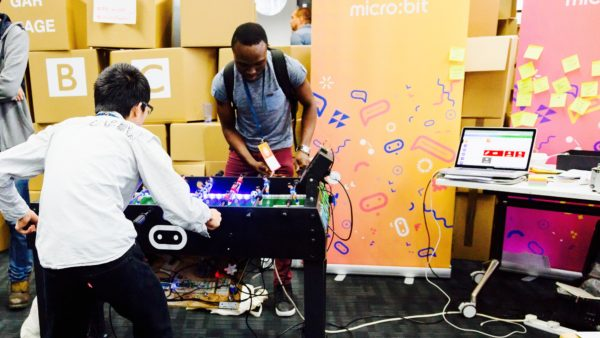 Students play a DIY, internet connected, digital foosball table at the Mozilla Festival