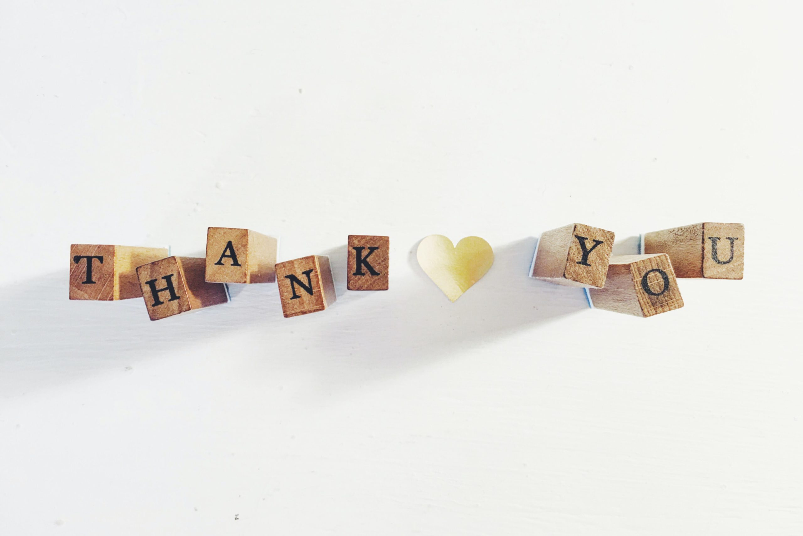 Blocks that spell out 'Thank You' with a heart in the middle