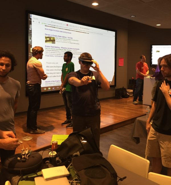 A KCVR Hackathon participant tests the Hololens during team networking.