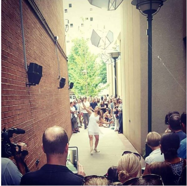 A member of the Chattanooga Ballet dances in the Passageways alley